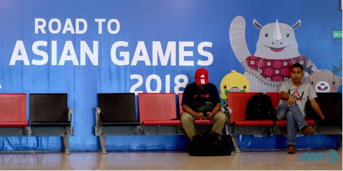 Lo que hay que hacer en una espera en un aeropuerto - Foto: GOH CHAI HIN / AFP